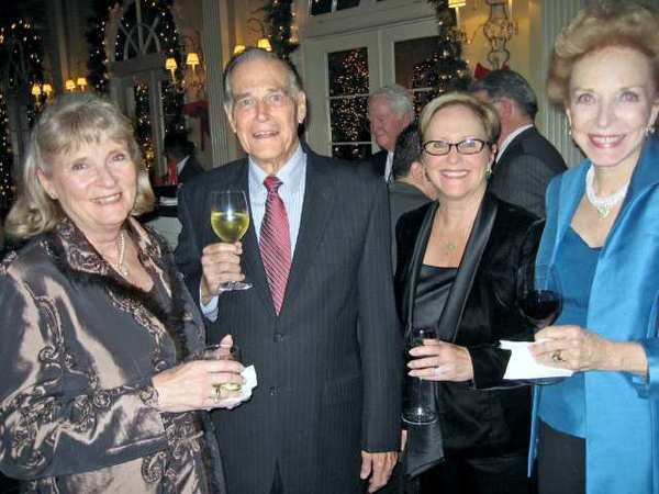 Las Candelas members, from left, Mary Boger, Newt Russell, Ann Jones and Diane Russell gather at the holiday party.