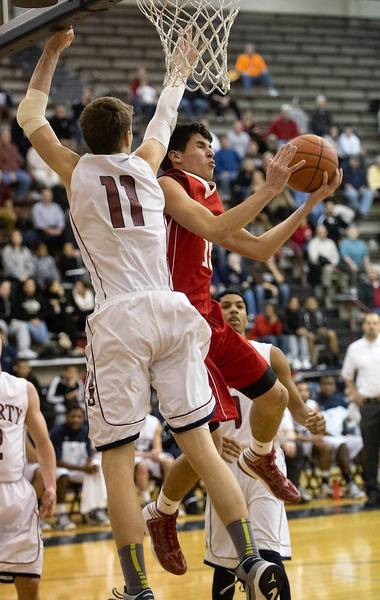 Liberty High School's Greg Noack (left) vies for a rebound with Parkland High School's Nicholas Rindock during Lehigh Valley Conference boys basketball game in Bethlehem on Tuesday.