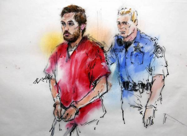 James E. Holmes is shown in a courtroom sketch being escorted to his preliminary hearing in Centennial, Colo.