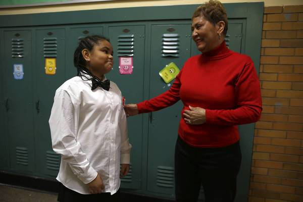 Carol Blocker talks with her 11-year-old granddaughter, Sommer Skyy Stokes, last month before her Christmas play at Lenart Elementary Regional Gifted Center in Chicago.