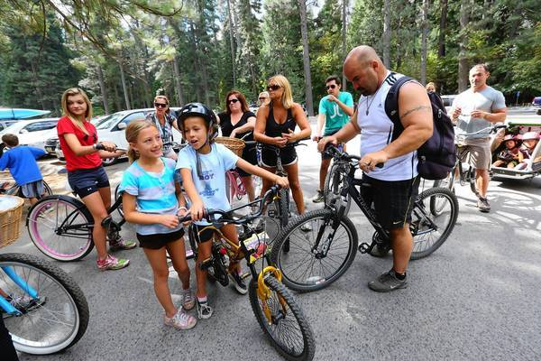 A group of families from San Jose gets ready for a bike ride in Curry Village at Yosemite National Park. The number of daily visitors would not be reduced under a National Park Service overhaul plan.