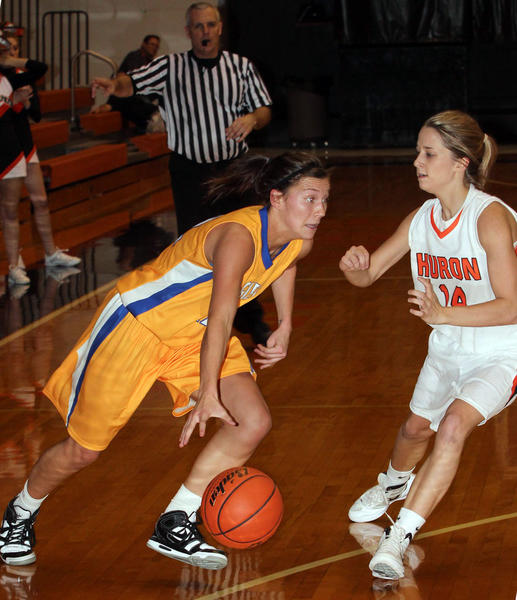 Aberdeen's Brynn Flakus drives against Huron's Taylar Rotert during their game Tuesday at Huron Arena