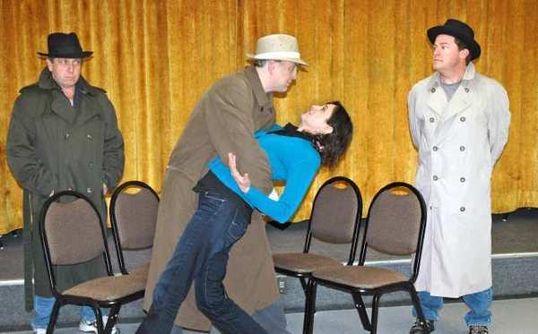"Performers with the St. Francis Stage Company in a scene from ""The 39 Steps"" are, from left, Jim Roope, Daniel Roebuck, Chenoa Mitsui and Chris Kenney."
