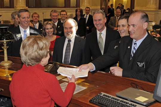 ov. Dennis Daugaard and others filed criminal justice reform legislation on Tuesday in the South Dakota Senate. Pictured, from left to right, are House Speaker Brian Gosch, Senate Appropriations Committee Chair Deb Peters, Supreme Court Chief Justice David Gilbertson, Daugaard, House Majority Leader David Lust and Sen. Majority Leader Russell Olson. In the foreground, is Carolyn Riter, assistant to the secretary of the Senate.