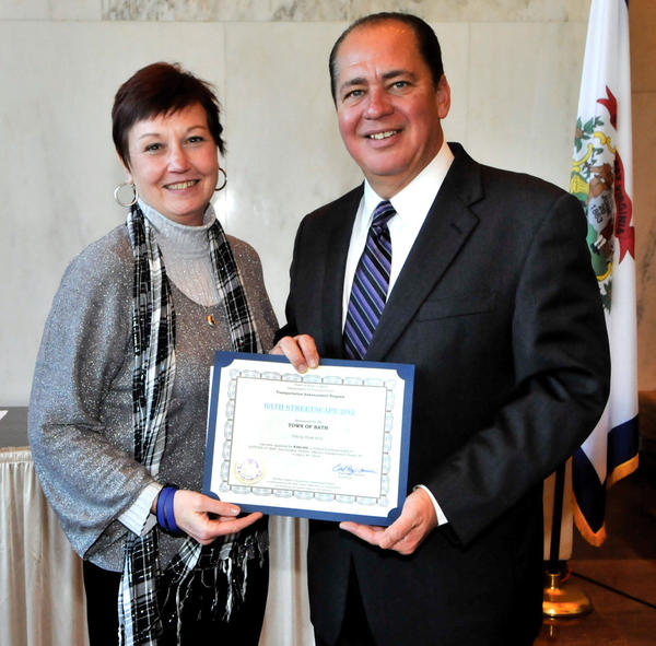 Town of Bath Mayor Susan Webster, left, accepts a $380,000 West Virginia Transportation Enhancement Grant from Gov. Earl Ray Tomblin for the town's Streetscape 2012 project.