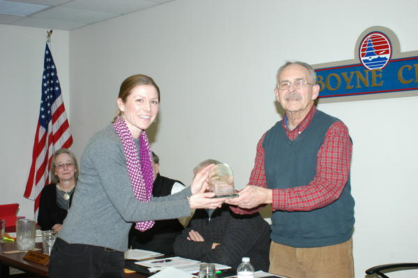 Boyne City Mayor Ron Grunch is presented a Promoting Active Communities Award by Erika Van Dam, family and community health supervisor for the Health Department of Northwest Michigan.