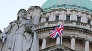 LONDON – After days of protest over its absence, the British flag flew over the Northern Irish capital of Belfast once again Wednesday, but for less than 24 hours and only then because of the newest, most glamorous addition to Britain's royal family.
