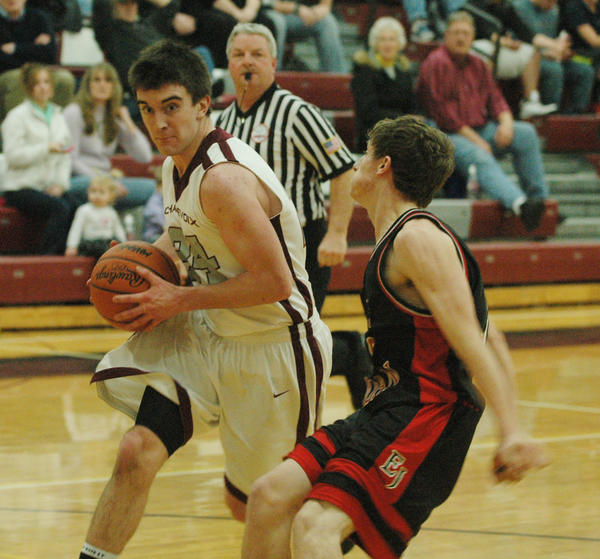 Charlevoix's Shane Sutherland (left) drives to the basket against East Jordan during Tuesday's Lake Michigan Conference contest at the Charlevoix High School gym.