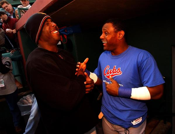 Barry Bonds (left) and Sammy Sosa share a laugh during 2003 spring training.