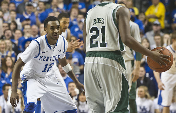 Kentucky sophomore Ryan Harrow (12) has earned the trust of his teammates with his improved overall play and now coach John Calipari wants him to strive to be the nation¿s best point guard as UK gets set to open SEC play at Vanderbilt Thursday.