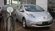 Nissan said Wednesday that it will offer a lower-priced version of its Leaf electric car this year and that it has begun making the Leaf and its battery pack at the automaker's giant factory complex in Smyrna, Tenn.