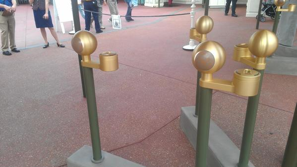 Golden-topped poles at the Magic Kingdom are part of the new MyMagic  entry system being tested at Walt Disney World theme parks.