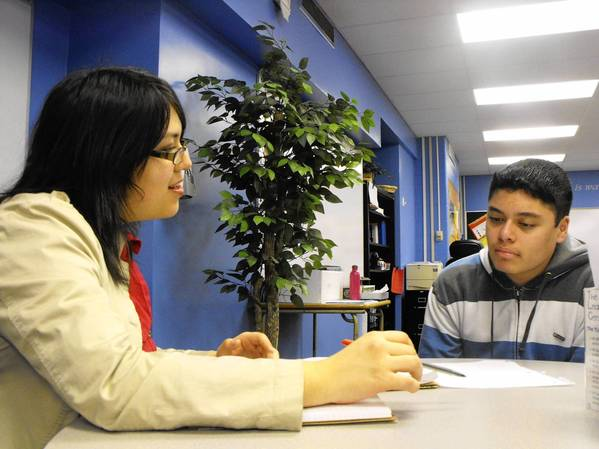 Cindy Camacho, the youth and family advocate for Family Service's Latino Youth Initiative, works with Highland Park High School sophomore Leno Betancourt, 15, after school Jan. 7. Camacho said her work could be restructured next year due to funding changes for the Latino Youth Initiative.