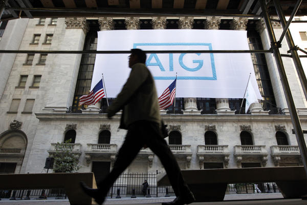A banner for American International Group Inc (AIG) hangs on the facade of the New York Stock Exchange. AIG announced it would consider joining a multi-billion dollar suit against the U.S. government that claims the United States charged unfair interest rates when saving AIG from complete collapse during the 2008 Wall Street bailouts.