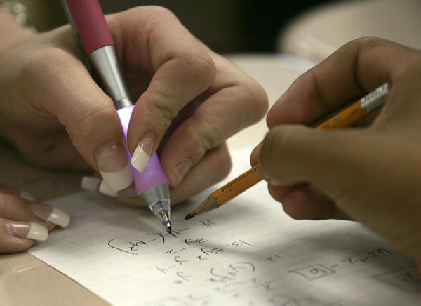 Students work on math problems at Martin Luther King High School in Riverside.