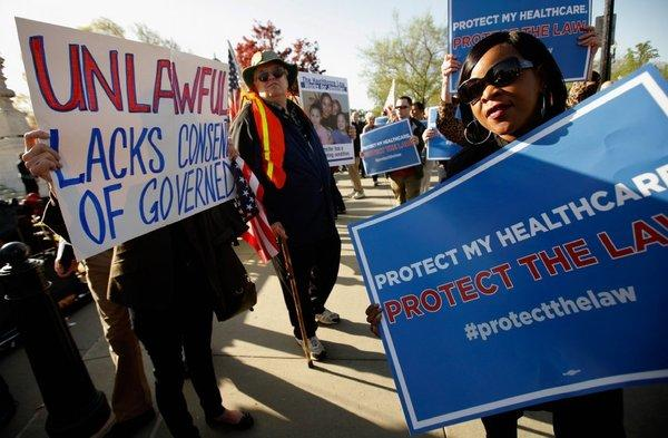 Supporters and opponents of the 2010 Affordable Care Act demonstrate outside the Supreme Court, which declared the law and its coverage requirements constitutional.