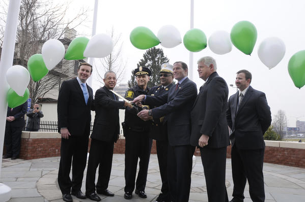 U.S. Sen. Chris Murphy, Mayor Pedro E. Segarra, Police Chief, James C. Rovella, Fire Chief Eward Casares, Jr., Sen. Richard Blumenthal, Congressman John Larson, and Andrew Jaffee, Director Of Emergency Services and Telecommunications, cut the ceremonial ribbon at the Hartford Public Safety Complex.