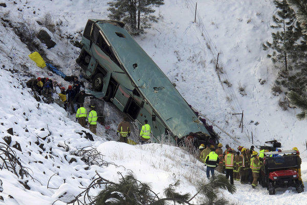Emergency personnel responded to the scene of a fatal accident after a tour bus careened through a guardrail along an icy highway and fell down a steep embankment.