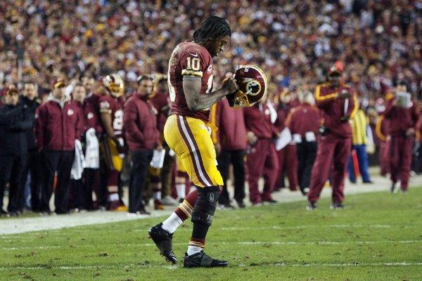 Robert Griffin III walks back to the huddle during Sunday's game against Seattle.