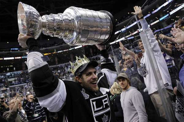 Center Anze Kopitar shows Kings fans an upclose look at the Stanley Cup last season.