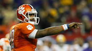 Clemson QB Tajh Boyd announced Wednesday that he was returning to the school for his senior season.