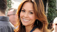 "Brooke Burke-Charvet displayed the scar from her thyroidectomy Tuesday on ""Good Morning America,"" admitting that the makeup-free show-and-tell was a first for her, as she'd been ""scarfing it up"" — as in, covering it up — until now."