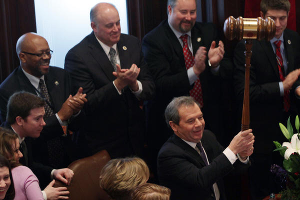 Sen. John Cullerton holds a giant gavel after being re-elected as the chamber's president in Springfield. A new Illinois General Assembly was sworn in.