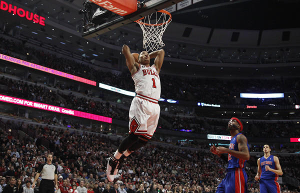 Chicago Bulls point guard Derrick Rose (1) dunks the ball on a breakaway while Detroit Pistons shooting guard Richard Hamilton (32) watches during the  second quarter of their game at the United Center, in Chicago, January 10, 2011.     (Nuccio DiNuzzo/ Chicago Tribune)  ....OUTSIDE TRIBUNE CO.- NO MAGS,  NO SALES, NO INTERNET, NO TV, NEW YORK TIMES OUT, CHICAGO OUT, NO DIGITAL MANIPULATION