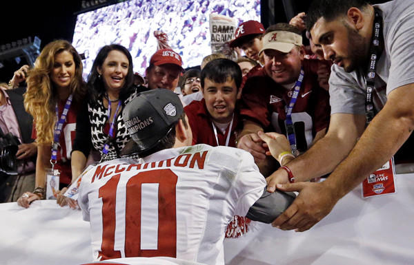 Alabama quarterback AJ McCarron celebrates with family and friends, including girlfriend Katherine Webb, left, after winning the BCS national title on Monday night.