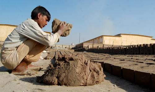 Shahzad, 12, makes bricks at the kiln. He dreams of going to school instead.