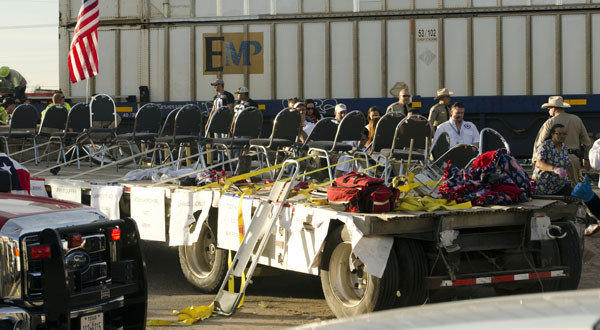 Authorities respond to an accident involving a flatbed truck carrying wounded veterans that was struck by a train during a parade in Midland, Texas.