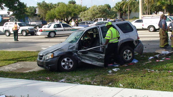 A woman had to be freed from one of two mangled SUVs after a crash in Pompano Beach