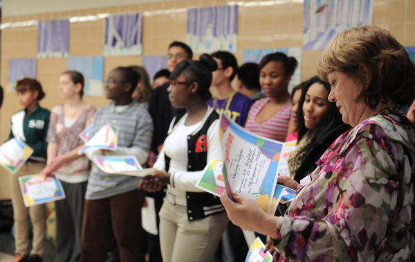 Karol Kleppinger, aan art teacher at South Mountain Middle School hands out certificates at a dedication ceremony to the 16 students who painted a 61' x 8' mural entitled, 'Celebrating Allentown -  250 Years' at South Mountain Middle School on Wednesday.