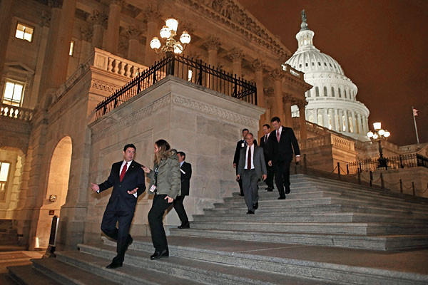 "Members of the House of Representatives leave after voting for legislation to avoid the ""fiscal cliff"" during a rare New Year's Day session January 1, 2013."