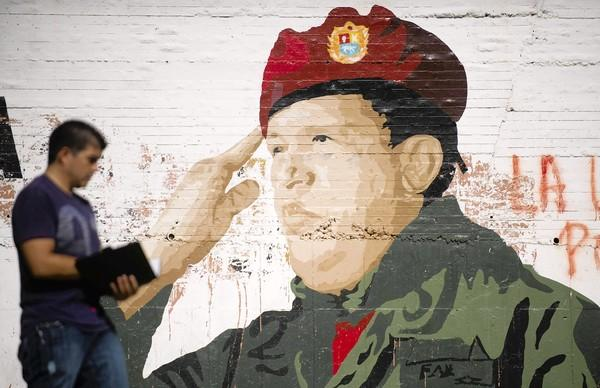 A mural of Venezuelan President Hugo Chavez, who is out of the country being treated for cancer, adorns a wall in Caracas.