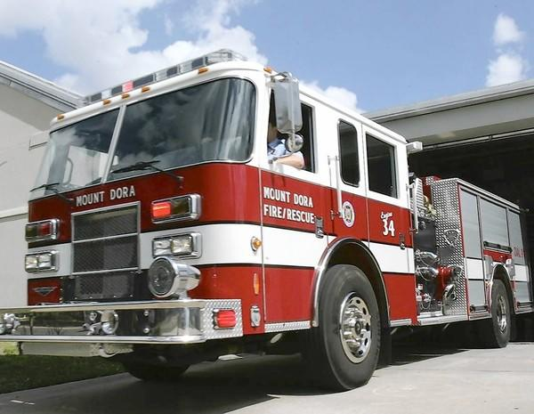 A fire engine leaves the Mount Dora Fire Department on Thursday, March 3, 2011.