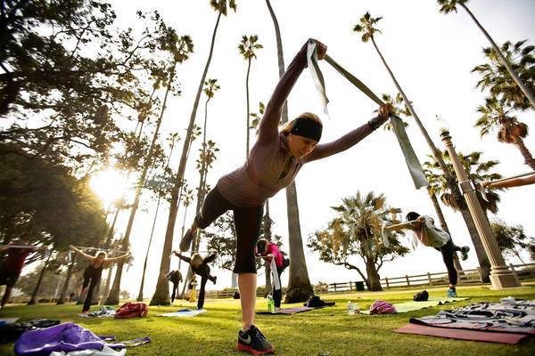 Trainer Angela Parker leads her class in a workout at Palisades Park along Ocean Avenue in Santa Monica. The city isn't alone in its struggle to deal with complaints about crowds of fitness fanatics.