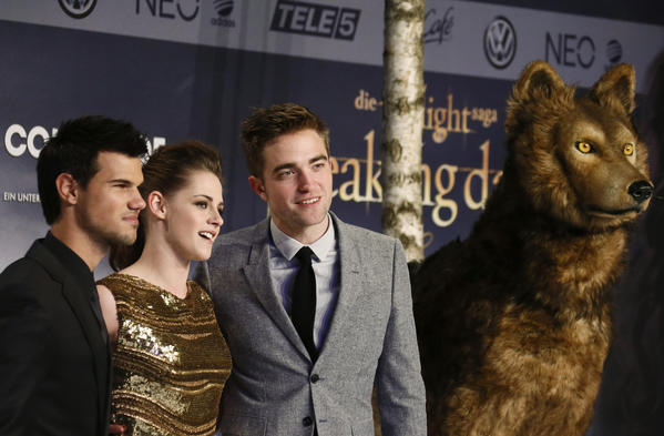 Cast members Robert Pattinson, Kristen Stewart and Taylor Lautner pose for pictures before the German premiere of The Twilight Saga: Breaking Dawn Part 2 in Berlin.
