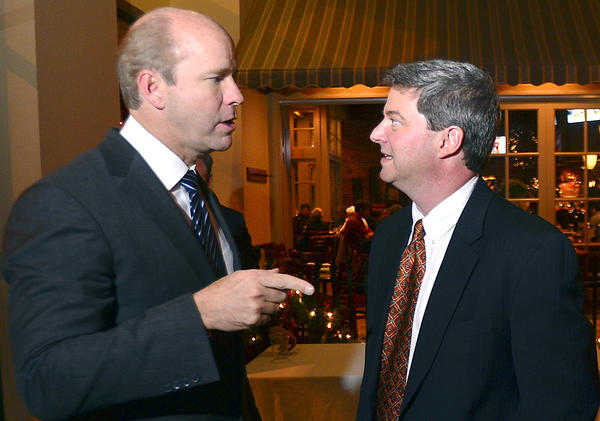 U.S. Rep. John Delaney speaks with Brien Poffenberger, president of the Hagerstown-Washington County Chamber of Commerce Wednesday during a welcoming reception for Maryland's newest member of the House of Representatives.