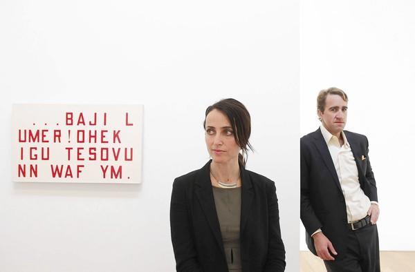 "Samuel Freeman gallery director Amy Thoner, center, and Samuel Freeman, right, stand near Guy de Cointet's piece ""Sophie Rummel (4)."""