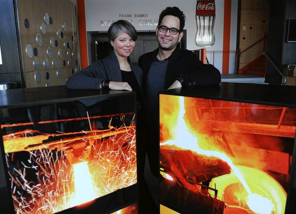 Jamie and Mike Cabreza created moveable photo cubes covered with images of molten steel for an installation at the ArtsQuest Center in Bethlehem called 'Blast Furnace.' The couple are the owners of iMiJ Shop in downtown Easton.