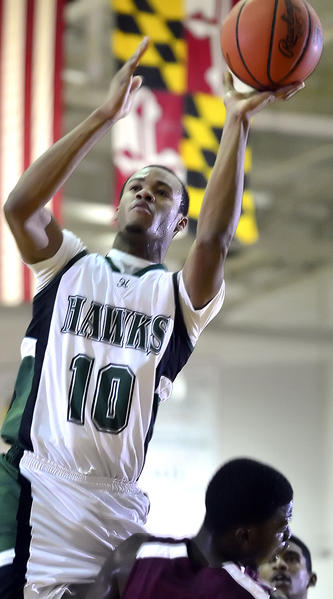Hagerstown Community College's Antonio Jenifer shoots the ball over Howard Community College's Alie Kondeh and Brandon Spain during Wednesday's Maryland JuCo game at HCC.