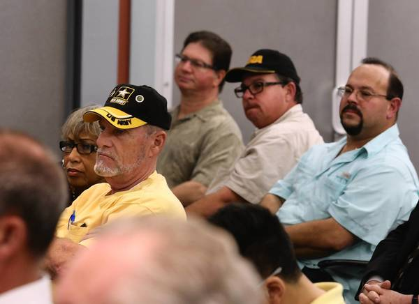 Attendees listen to the panel at the Orlando Sentinel Wednesday night. The Sentinel and Fox 35 News presented a discussion about the role of guns in society and culture.