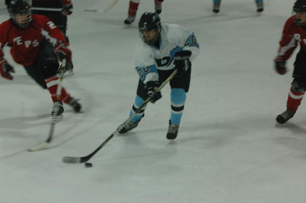 Petoskey junior forward Ben Schwartzfisher scored three goals Wednesday to lead the Northmen to a 5-4 win over the Bay Area Reps at Griffin Arena. With the win, the Northmen improve to 7-6-0 overall, 5-1-0 Northern Michigan Hockey League.