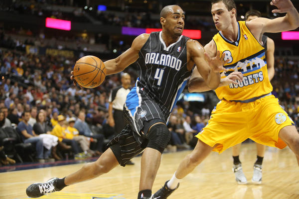 Orlando Magic guard Arron Afflalo (4) drives to the basket against Denver Nuggets forward Danilo Gallinari (8) during the first half at the Pepsi Center