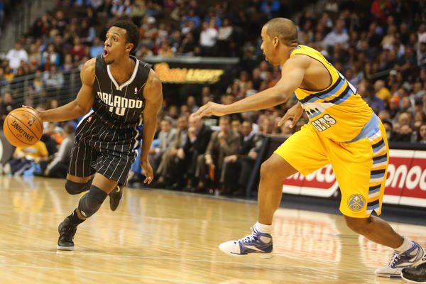 Orlando Magic guard Ish Smith (10) drives to the basket during the first half against the Denver Nuggets at the Pepsi Center