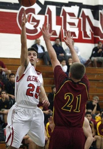 Glendale's Arada Zakarian, left, goes for a layup against Arcadia.