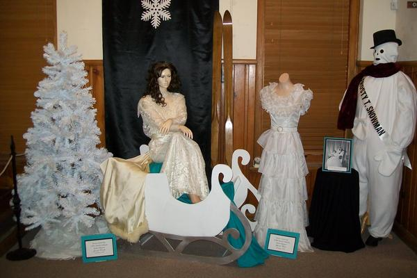 A sleigh, dresses and Frosty costume are part of the Snow Queen exhibit at the Dacotah Prairie Museum.
