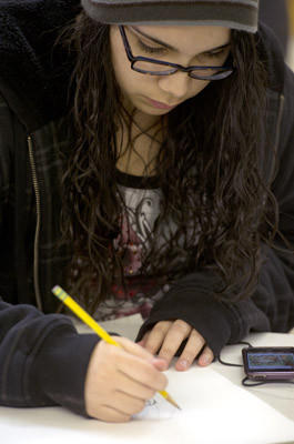 Jaileen Cortes-Soto, age 14 of Catasauqua, draws as Baum School students learn drawing from Chuck Vlasics in the Teenage Scholarship program at the Baum School of Art in Allentown on Tuesday.