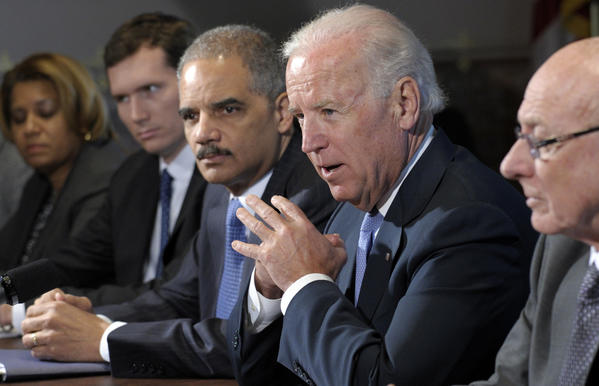 Vice President Joe Biden, with Attorney General Eric Holder at left, speaks during a meeting with victim's groups and gun safety organizations in the Eisenhower Executive Office Building on the White House complex in Washington, Wednesday. Biden is holding a series of meetings this week as part of the effort he is leading to develop policy proposals in response to the Newtown, Conn., school shooting.
